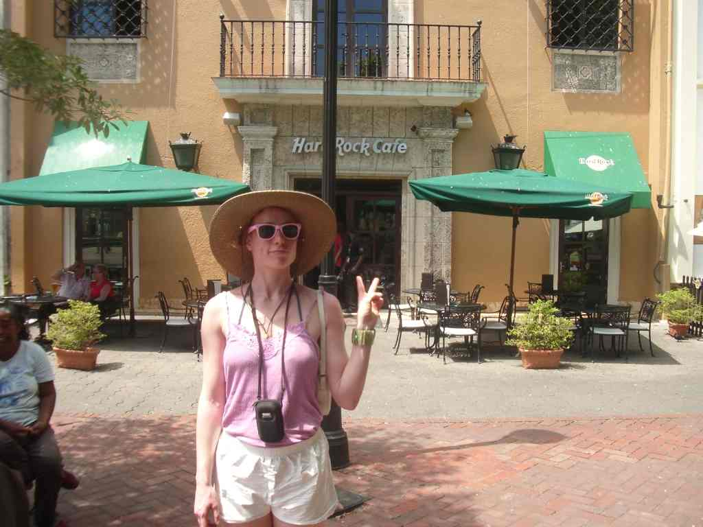 Joana poses in front of the Hard Rock Cafe